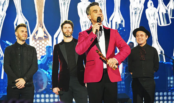Robbie Williams performs with Take That at special gig but is he Back For Good?