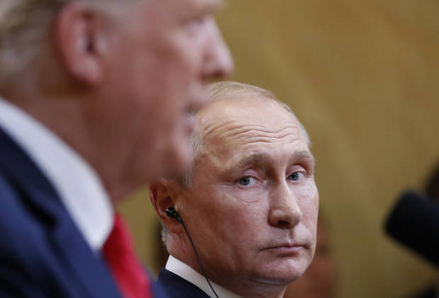 The Latest: Putin rejects collecting dirt on Trump