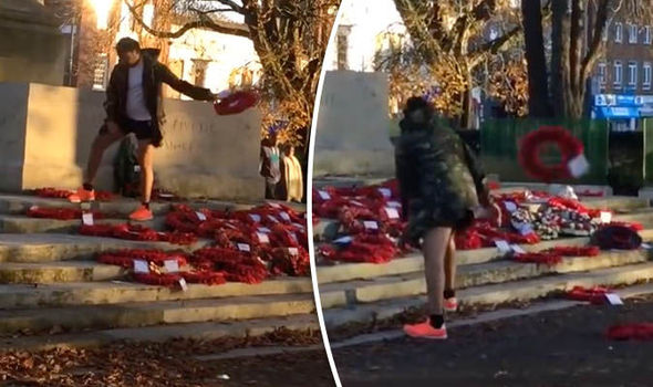 Outrage as 'disgusting' thug hurls poppy wreaths off war memorial in shocking video