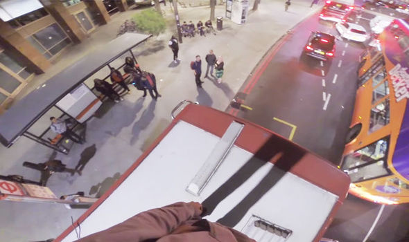Daredevil branded 'idiot' after filming himself SURFING on top of double-decker bus