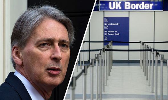 Philip Hammond 'tells Brexiteers to DELAY migration talks and warns AGAINST hard Brexit'