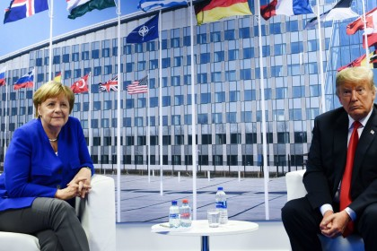 Nato summit: Donald Trump and Angela Merkel wage war of words