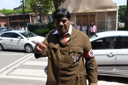 Indian MP arrives at parliament dressed as Hitler